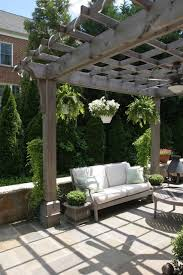 Hanging Plants For Patio Natural Wood Pergola With Hanging Plants Over Flagstone Patio