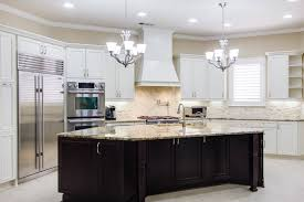 grey wooden kitchen cabinet and island with black countertop and