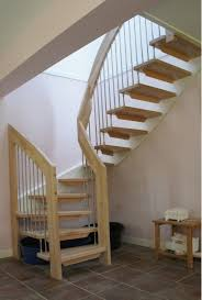 staircase designs for small homes with chrome metal stair pole be