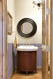 bathroom exciting black rounded mirror over white single sink