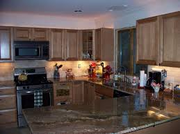 granite countertop dark cabinets kitchen wall color how to tile