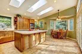 Green Country Kitchen Large Green Country Kitchen With Skylights And Wood Cabinets