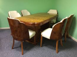 art deco dining table and six chairs by harry and lou epstein at
