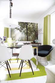 contemporary dining room with white chairs black chair big white