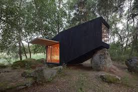 forest house small retreat house in the forest designed to rest on a giant boulder