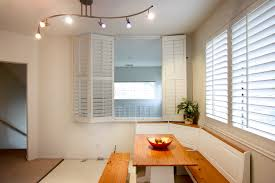 bi fold shutters from sunland shutters one open kitchen window