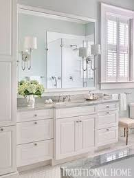 Master Bathroom With Herringbone Wood Floor Marble Shower And - White cabinets master bathroom