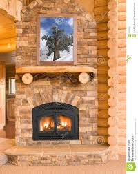 log cabin home interior with warm fireplace with wood flames a