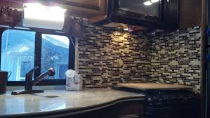 peel and stick tiles for the rv smart tiles peel and stick backsplash in a rv kitchen