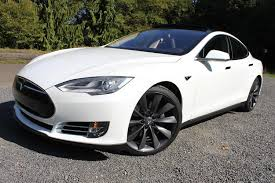 tesla model s charging the tesla model s and ford model t kicked off revolutions in