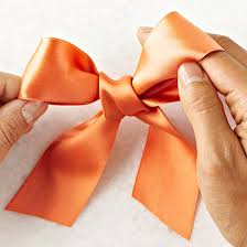 tie ribbon make a classic bow in 4 easy steps better homes gardens