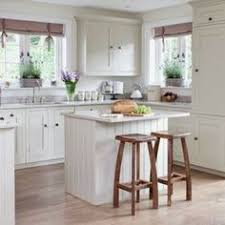 kitchen cabinet ideas for small kitchens as seen on hgtv s fixer the gray beadboard on the