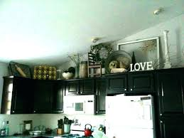 top of kitchen cabinet decorating ideas top of cabinet decor ideas brown rectangle traditional wooden
