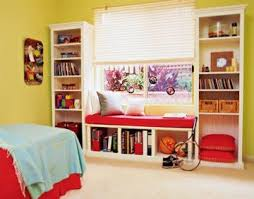 kids reading bench two bookcases alongside a window with a bench between makes an