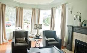 living room with long curtains using rods good bay window