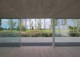 concrete pavilion by ppa overlooks a toulouse golf course