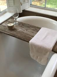 a gray wooden bath caddies