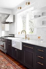 Gold Kitchen Cabinets - gorgeous blue and white kitchen boasts navy blue lower shaker