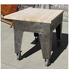 salvaged photo friday repurposed industrial furniture as a maple butchers block by removing the old cabinet and retrofitting a wood slab this old steel frame transformed into a fully functional and