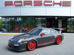 porsche slate grey 2010 porsche gt3 rs in grey black with red wheels and graphics