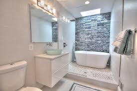 White Pebble Tiles Bathroom - contemporary master bathroom with freestanding bathtub by peter