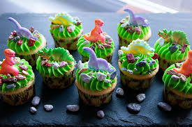 dinosaur cupcakes dinosaur cupcakes with sprinkles on top
