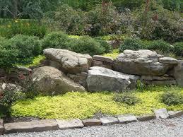 boulders in landscaping redbud design