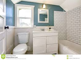 aqua bathroom with white tile wall trim stock photo image 42962351