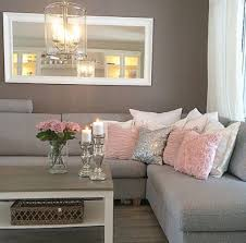 elegant grey l shaped sofa and romantic colored toss pillows for