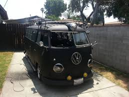 black volkswagen bus vw from the 60s that some guys fixed up pics
