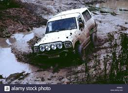jeep mud jeep four wheel drive crossing mud and water bad road off road