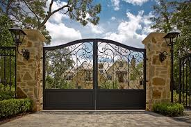 impressive wrought iron gates defining landscaping designs