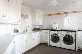 Laundry Cabinet With Hanging Rod Laundry Room Sink Flanked By Stacked Cabinets Transitional