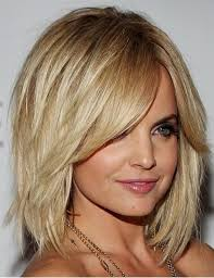 medium length hair with lots of layers hairstyles with bangs for round faces
