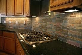 pictures of backsplash in kitchens dark tile backsplash espresso kitchens kitchen loving the vertical