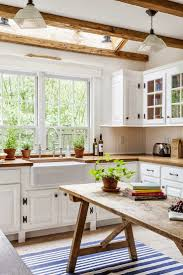 best ideas about cleaning wood tables pinterest small wood table counters and beams look good against all the creamy white
