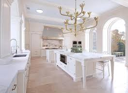 Kitchen Island With Legs Stainless Steel Kitchen Hood With Brass Trim Over Marble Spice