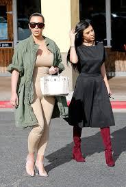nude photos of kim kardashian kim kardashian wears a nude catsuit with clear heels