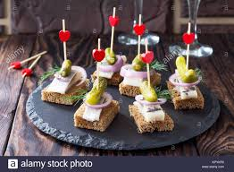 rye bread canapes canapes with rye bread herring and pickles on a festive table