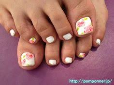 love feet adorned with jewelry and toes painted like candy