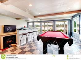 elegant entertainment room with pool bar and fireplace royalty