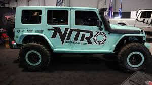 teal jeep rubicon jeep wrangler suvs at the 2016 sema aftermarket parts show