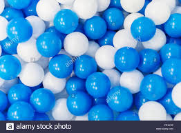 a lot of blue and white plastic balls in playroom stock photo
