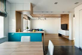 open kitchen and dining design interior in field wood flooring