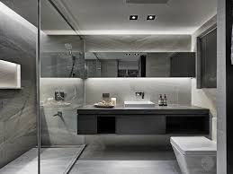 floating toilet and vanity with two sinks and a walk in shower