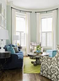 navy blue sofa gray ikat chairs light teal walls lime green