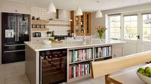 a harvey jones shaker kitchen with oak storage cupboard