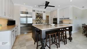 pearl white shaker cabinets in a casual kitchen omega