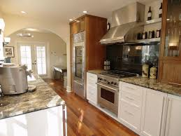 brown white two toned cabinets in kitchen for stainless steel