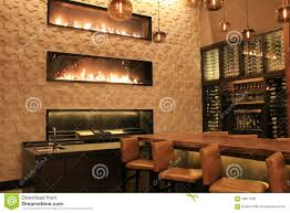 beautiful scene of bar with warm inviting fireplaces grand hyatt